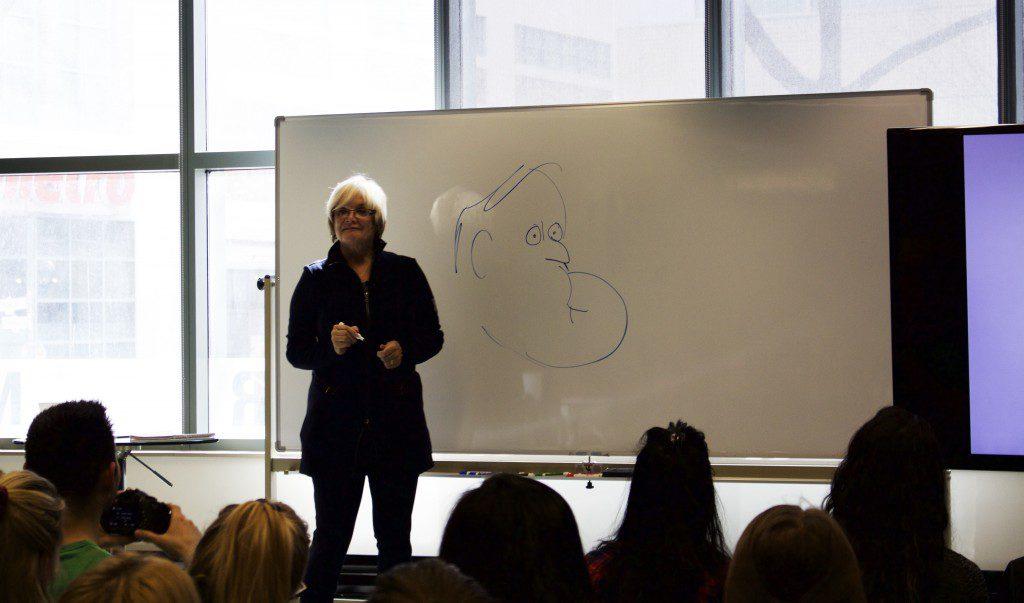 Dewar providing an example of her Brian Mulroney caricatures. (Photo: Robert Liwanag)