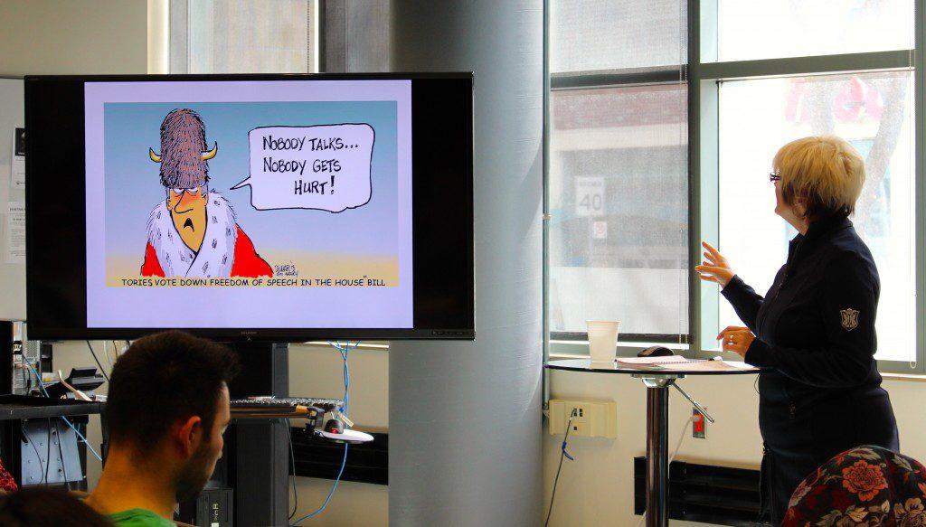 Cartoonist Susan Dewar presenting before an audience at the 2015 Atkinson Lecture. (Photo: Robert Liwanag)