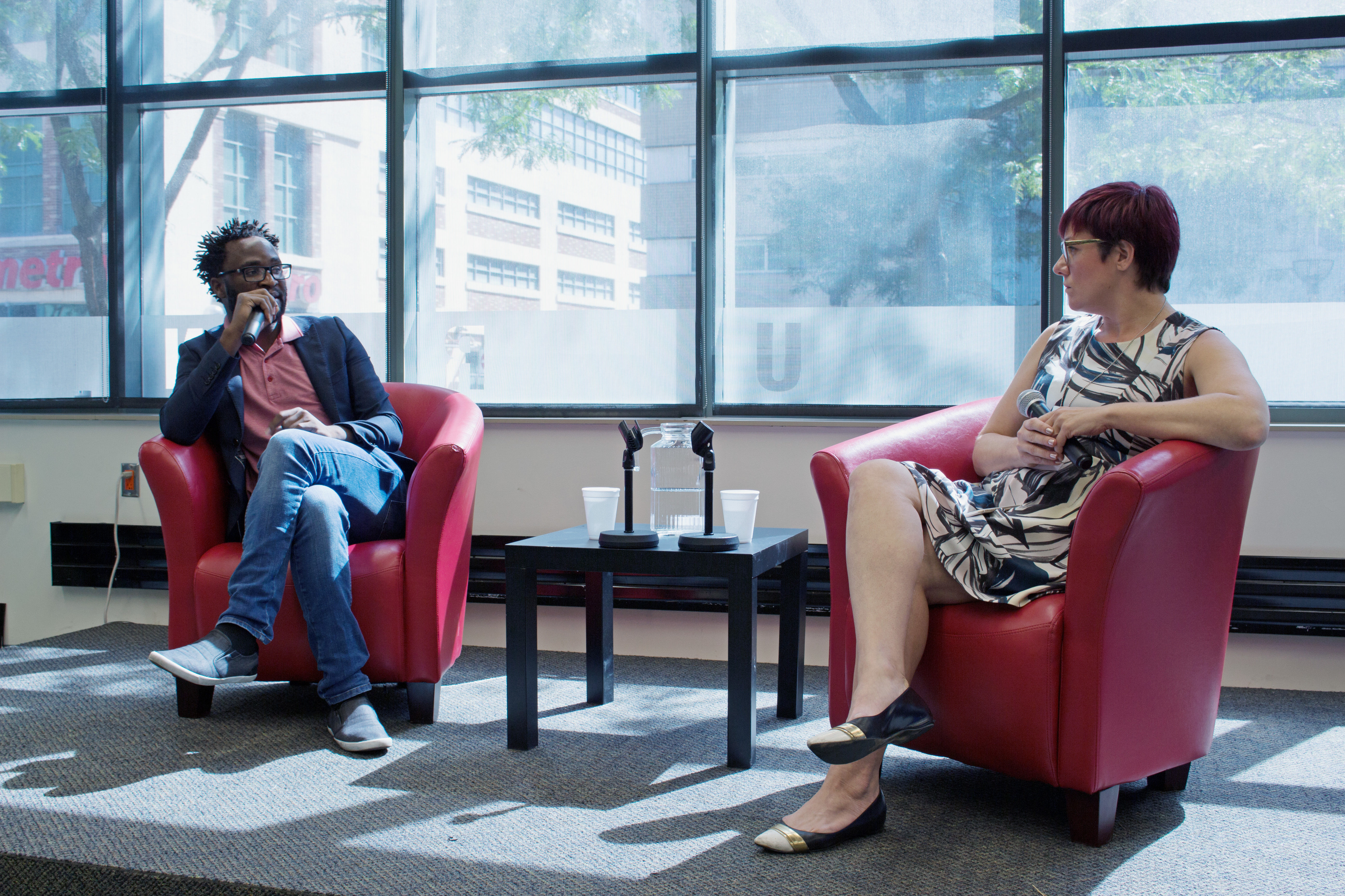 """Ugandan director Kamoga Hassan discusses his film, """"Outed: The Painful Reality,"""" with journalist and queer media instructor Andrea Houston. Photo: Jessica Ross"""