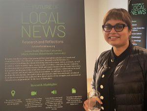 Ryerson journalism professor displays research at Ryerson event.